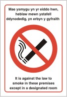 Dydy n ahghyfreithiol at fyga I mewn hyn premises eithria mewn n benofol hystafell It is illegal to smoke in these premises except in a designated room. sign.
