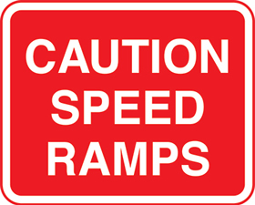 caution speed ramps with channels sign